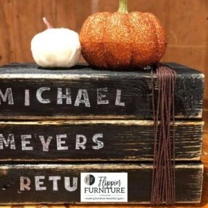 spooky halloween books painted black with white letters